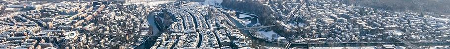 Luftaufnahmen Bern im Winter: Aare, Altstadt, Bahnhof Bern, Gurten, Grosse Allmend, Münster und viele mehr